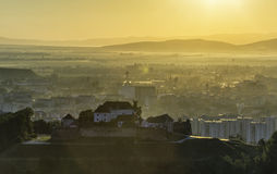 An old fortress on top of the hill during sunrise. In Brasov, Romania Stock Photos