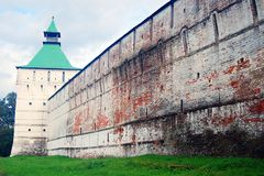 Old fortress tower. Green grass. Trinity Sergius Lavra Stock Photos