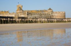 Old fortress wall and wooden stakes at Saint-Malo Stock Image