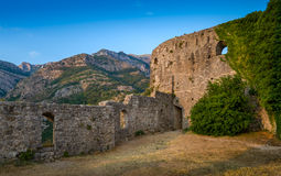 Old fortress walls and mountain range. Medieval fortress stone walls and mountain range. Town of Bar, Montenegro Stock Photography