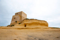 Old fortress in Xlendi, Gozo, Malta. Fortress at yellow sandstone at Xlendi, Gozo island, Malta Stock Photography