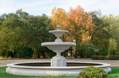 Old fountain in autumn park. Stock Photos