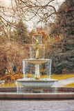 The old fountain. In the English park on the cloudy cold winter day Royalty Free Stock Images