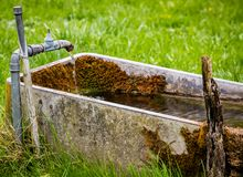 Old Fountain in a Field Royalty Free Stock Image