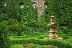Old fountain in green garden Royalty Free Stock Images