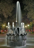 Old fountain at night in the park Royalty Free Stock Image