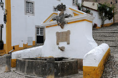 Old fountain in Obidos Royalty Free Stock Photos