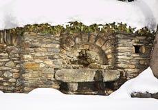 Old fountain in Ordino. Andorra.  Stock Photo