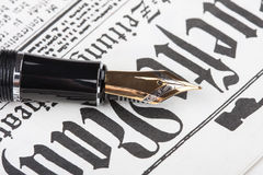 Old fountain pen and newspaper Stock Images