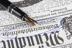 Old fountain pen and newspaper Royalty Free Stock Images
