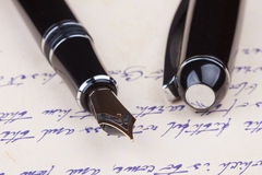 Old fountain pen and old manuscript Stock Images