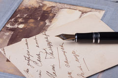 Old fountain pen and old Photo album Stock Image