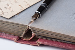 Old fountain pen and old Photo album Stock Photos