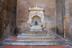 Old fountain with small boy on a dolphin on Cavour square in Rim Royalty Free Stock Photos