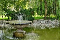 Old Fountain Stone Cup  And Pond in the City Park Royalty Free Stock Photography