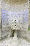 Old fountain with stone mosaics Stock Photos