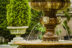 Old Fountain in the Summer Park. Detail of an old classic style Stock Photography