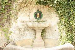 Old Fountaun Cesky Krumlov. Old fountain in Cesky Krumlov garden with vine plants stock image