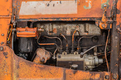Old  four cylinders engine. Old orange rusty four cylinders engine Stock Images
