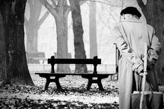 Old frail man. In the autumnal park Stock Photography
