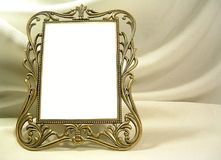 Old Frame. An old frame against a fabric backdrop-room for copy Stock Images
