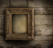Old frame against a  painted wall Royalty Free Stock Photos