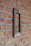 Old frame on brick wall. Old wooden frame on brick wall Royalty Free Stock Images