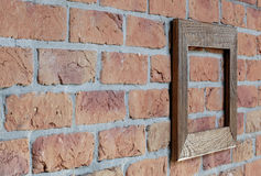 Old frame on brick wall. Old wooden frame on brick wall Royalty Free Stock Image