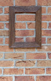 Old frame on brick wall Stock Photo