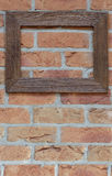Old frame on brick wall. Old wooden frame on brick wall Stock Photography