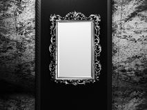 Old frame on the dark wall Stock Photos