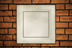 Old frame on fracture brick Royalty Free Stock Photography