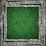 Old frame with green striped canvas Stock Images