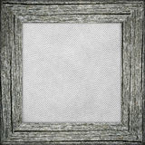 Old frame with grey striped canvas. Old raw wooden frame with grey striped canvas Royalty Free Stock Images