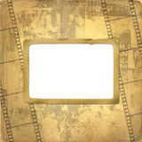 Old frame and grunge  filmstrip. On the grunge background Royalty Free Stock Images