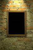 Old frame hanging on the wall Stock Image