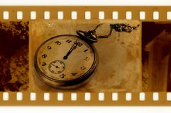 Old frame photo with vintage clock. Old 35mm frame photo with vintage clock stock photography