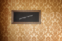 Old frame with a wide empty space. Vintage wallpaper. Stock Image