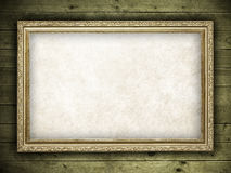 Old frame on wood background Royalty Free Stock Photo