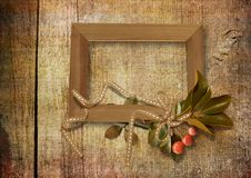 Old frame on wooden background Royalty Free Stock Photos