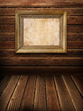 Old frame on wooden wall Royalty Free Stock Photo