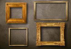 Old frames hanging on wall Stock Photo