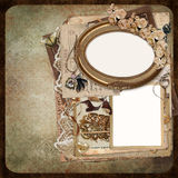 The old frames, vintage jewelry, old documents on the vintage shabby background Royalty Free Stock Photography