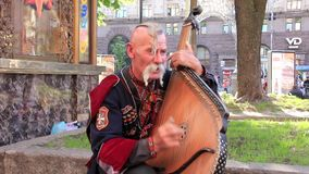 Old free Cossack. Bandura player. Bandura - Ukrainian string instrument stock video