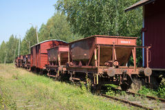 Old freight cars on abandoned railway station. Porvoo, Finland. PORVOO, FINLAND - AUGUST 20, 2016: Old freight cars on abandoned railway station. Historical Stock Photography