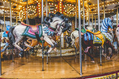 Old French carousel in a holiday park. Three horses and airplane Stock Images