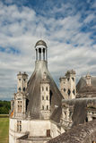 Old French castle with cloudy blue sky background Royalty Free Stock Photos