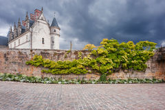 Old French castle on dramatic sky background Stock Images
