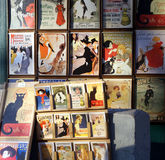 Old French commercial ads. Various old french commercial ads, for sale in Montmartre quarter in Paris, France. Posters and postcards stock images