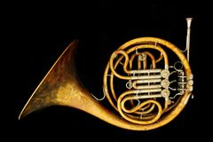 Old french horn. Isolated on the black background Royalty Free Stock Photography